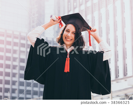 woman with diploma, graduation cap and gown  38366325