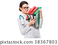 Angry young woman doctor with stethoscope holding 38367803