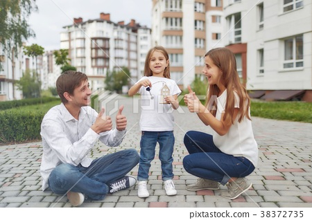 Happy family in front of new apartment building 38372735