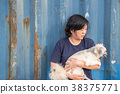 Asian woman and dog happy hugging with container 38375771