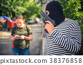 Robber trying to snatching money and bag  38376858