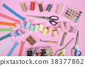 Flat lay of sewing accessories. 38377862