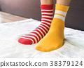 Legs in socks two colors alternate. 38379124
