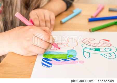 "Girl writing ""Summer Vacation"" using felt-tip pen 38383589"