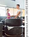 woman mechanic tires 38385399
