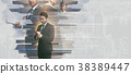 Double exposure of a businessman working  38389447