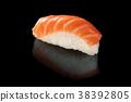 Salmon sushi on black. 38392805