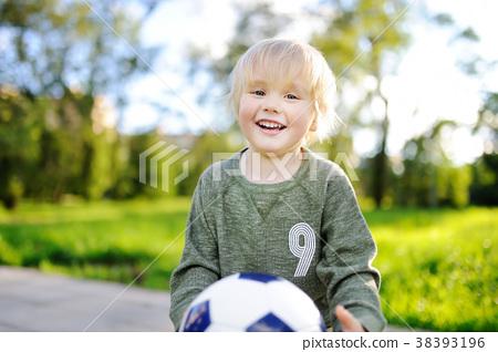 Little boy having fun playing a soccer game 38393196
