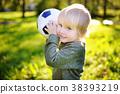 boy having fun playing a soccer game 38393219