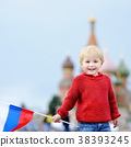 Cute boy holding russian flag 38393245