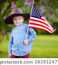 Cute toddler boy holding american flag 38393247