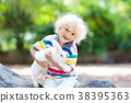 Child with rabbit. Easter bunny. Kids and pets. 38395363