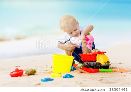 Kids play on tropical beach. Sand and water toy. 38395441
