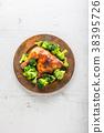 Roasted chicken Leg. Chicken leg with broccoli. 38395726