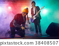 Teenagers are playing rock. 38408507