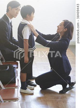 Parents and children waiting for the exam interview 38409443