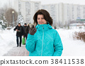 Woman looks on phone in city of Moscow, Russia 38411538