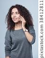 Closeup portrait of curly female 38412811