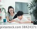 Asian boy with mother teaching your homework. 38424371