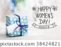 Happy Womens Day message with gift box 38424821