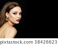 Portrait of young woman with beautiful makeup 38426623