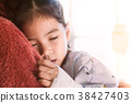Sick asian girl is sleeping on mother shoulder 38427403