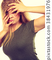 Ashamed embarrassed blonde woman with hands on face 38431976