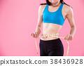 woman take waist scale 38436928