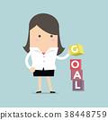 Businesswoman is building GOAL cubic box puzzle 38448759