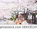 Asian Couple lover traveler sightseeing sakura 38459530