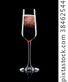 Rose pink champagne glass with bubbles on black 38462544