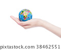 Female hand holds world globe on white background. 38462551