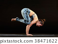 Woman demonstrating a crow pose in yoga 38471622