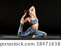 Young woman doing a mermaid or pigeon pose 38471638