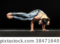 Muscular fit woman doing a side crow yoga pose 38471640
