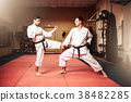 Martial arts masters, self-defence practice in gym 38482285