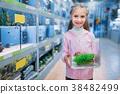 Little girl with plant for aquarium in pet shop 38482499