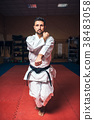 Martial arts master on fight training in gym 38483058