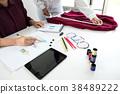 Two professional stylish fashion designer working as fashion des 38489222