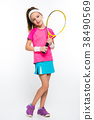 Cute little girl with tennis racket in her hands 38490569
