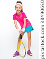 Cute little girl with tennis racket in her hands 38490650