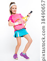 Cute little girl with tennis racket in her hands 38490657