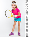 Cute little girl with tennis racket in her hands 38490678