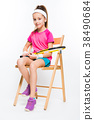 Cute little girl with tennis racket in her hands 38490684