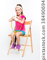 Cute little girl with tennis racket in her hands 38490694
