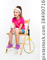 Cute little girl with tennis racket on white 38490716