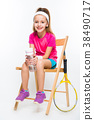 Cute little girl with tennis racket on white 38490717