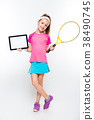 Cute little girl with tennis racket and tablet in 38490745