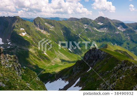 valley with snow in summer mountains 38490932