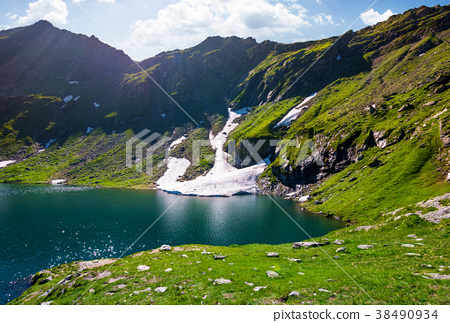 lake Balea in Fagaras mountains on a bright sunny 38490934